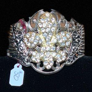 Silver metal bracelet with gold emblem angel wings